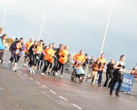 The-orange-team-crossing-the-line---Hastings-half-Marathon-2014